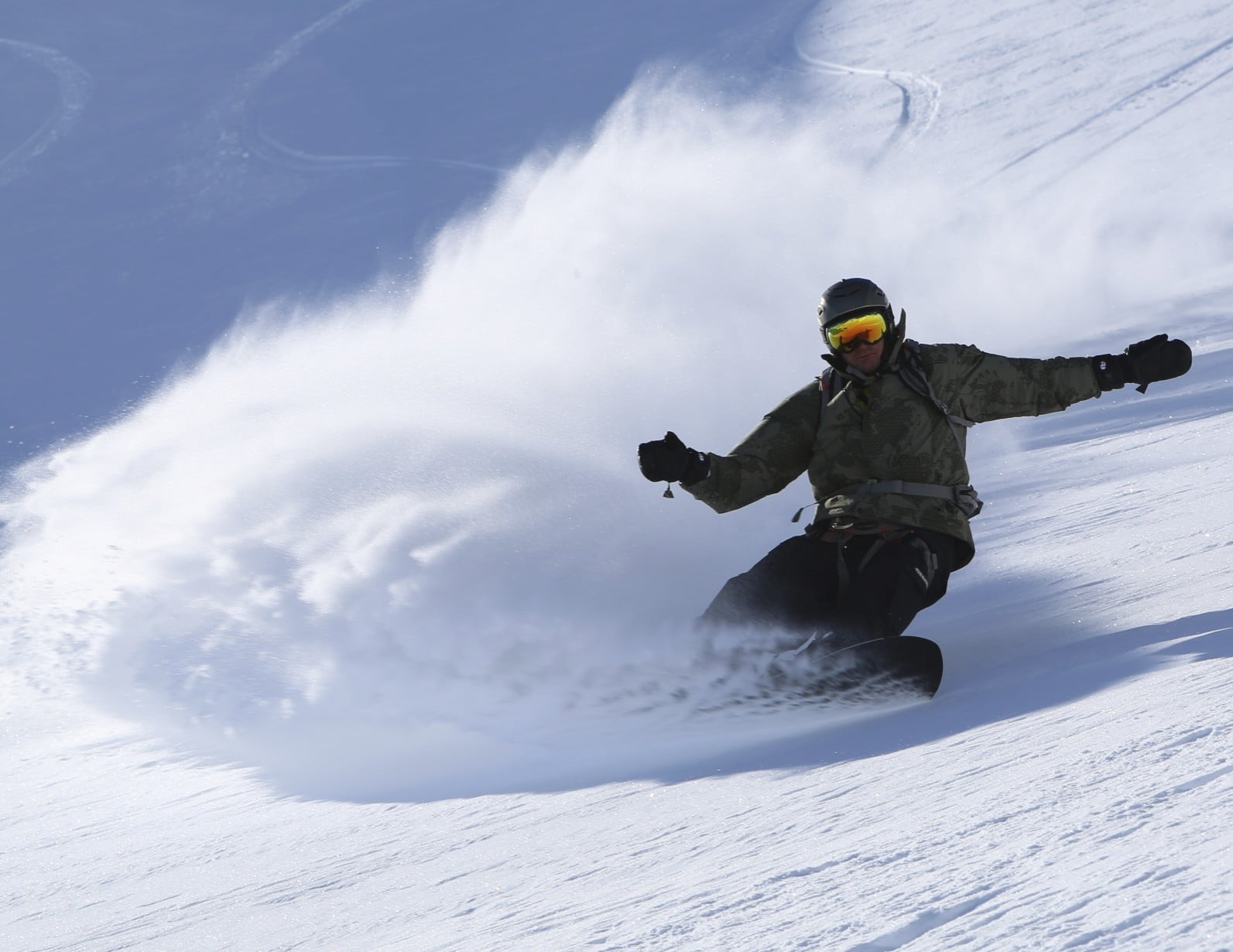 Big Wave Surfer Laird Hamilton is heli snowboarding at Tordrillo Mountain Lodge