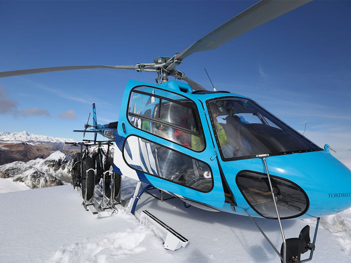 A Eurocopter A-Star gets ready to take off from the Tordrillo Mountains.
