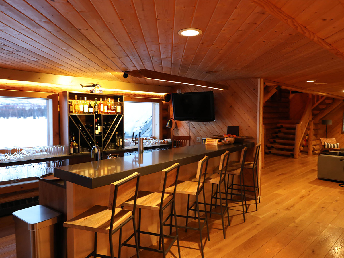 An inside view of the Tordrillo Mountain Lodge lakeside bar in Alaska.