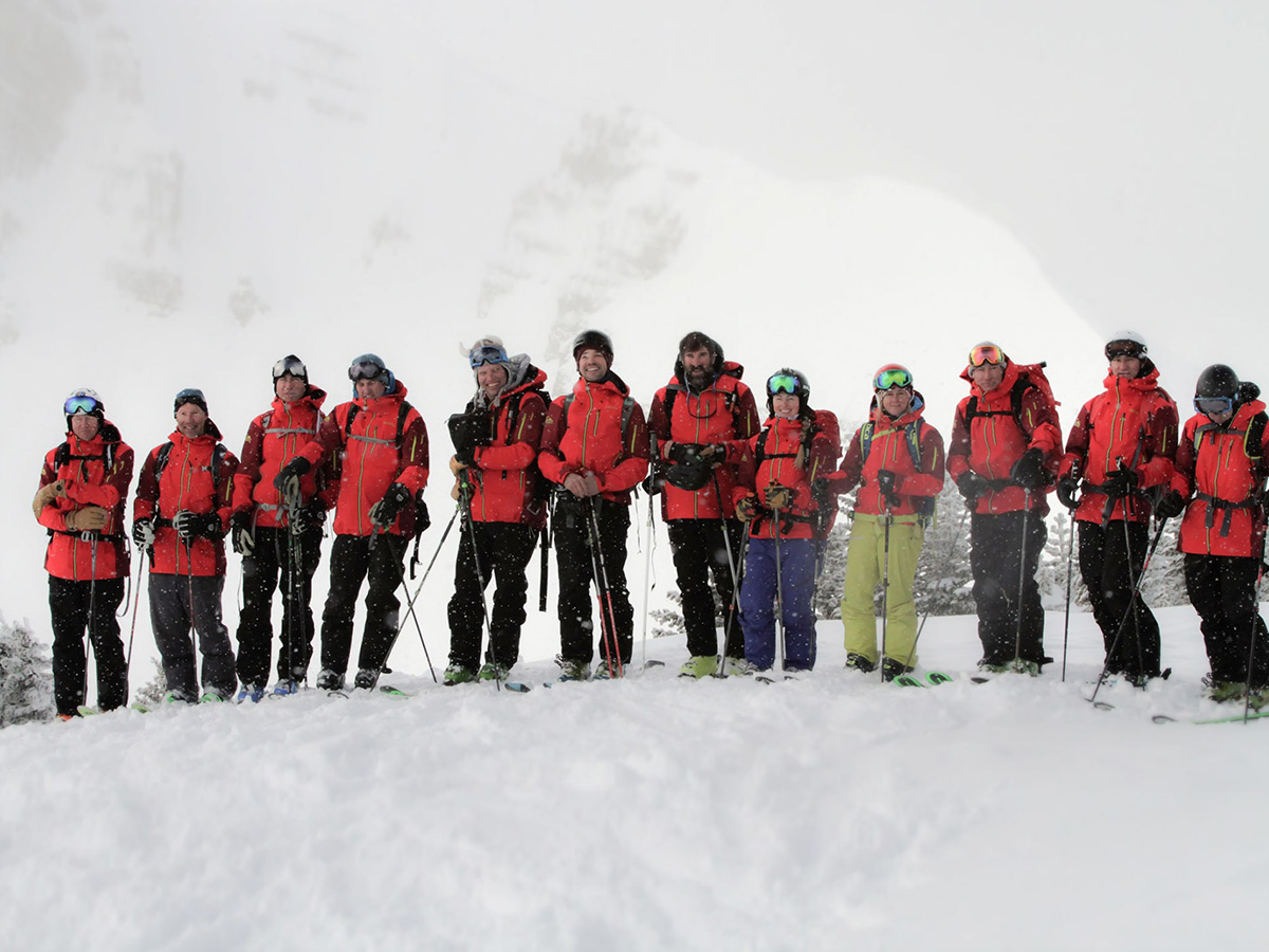 A group of Tordrillo Mountain Lodge guides get ready for a day of heli skiing.
