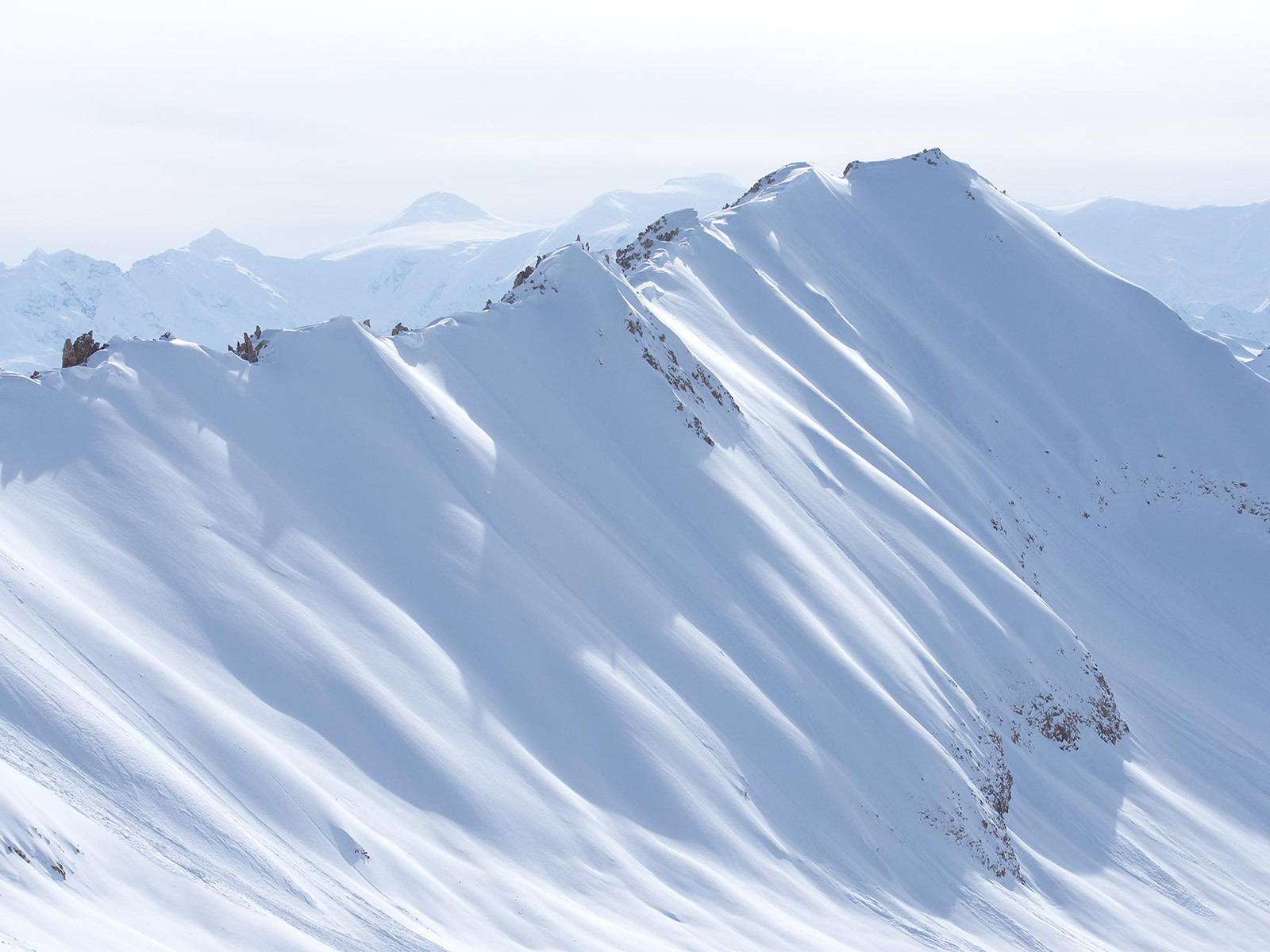 Alaskan mountain ridge covered in snow.