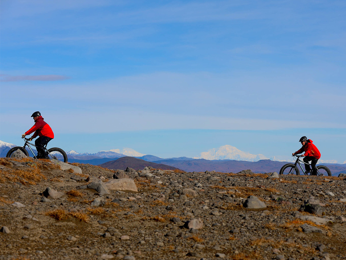 Two mountain bikers spend an afternoon biking through the Tordrillo Mountains.