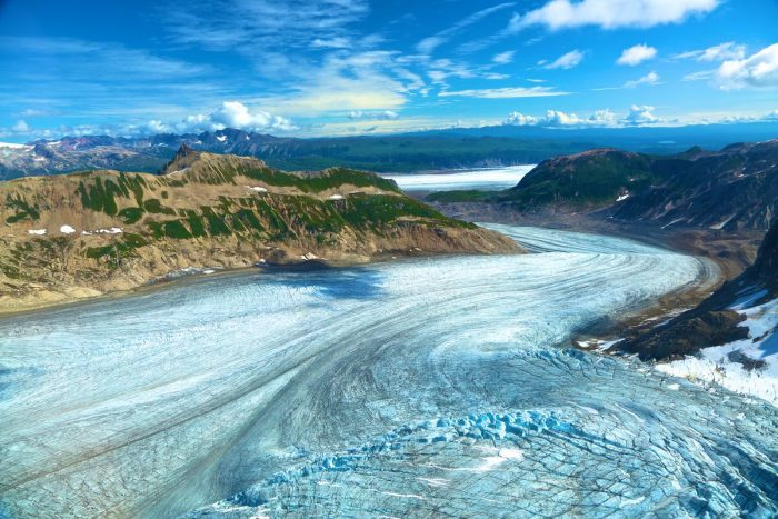 Birds eye view of a large glacier on a summer day in the Tordrillo Mountains.
