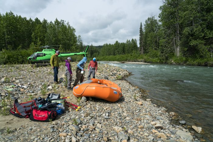 A group of guests from Tordrillo Mountain Lodge get dropped off by helicopter for a day of Alaska rafting.