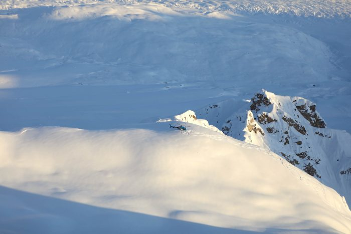 A helicopter landed at the top of a peak in the Tordrillo Mountains in Alaska.