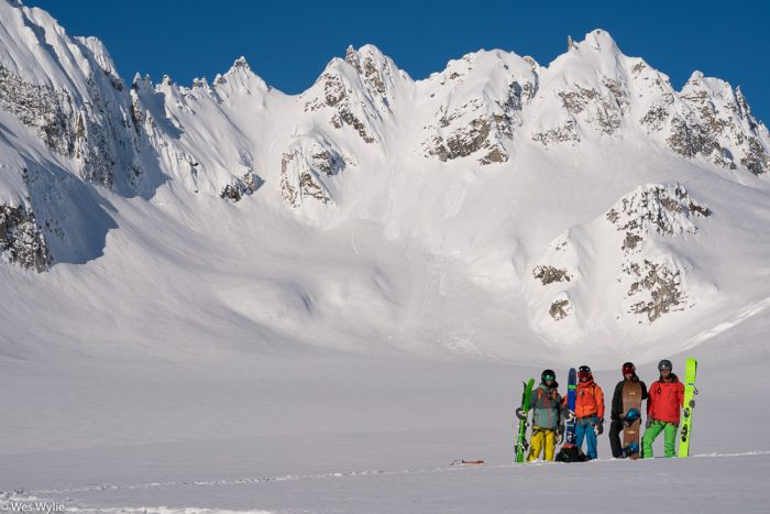 A ski group stands at the base of runs in the Tordrillo Mountains in Alaska.